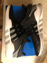 pair of black-and-white Adidas cleats London, N6G 3A1