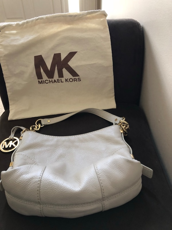 23aadf6c9306 Used MK cream purse with dust cloth bag for sale in Norcross - letgo