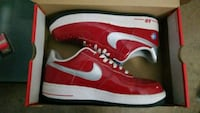 pair of red Nike Air Force 1 low shoes Toronto, M5B 2P7