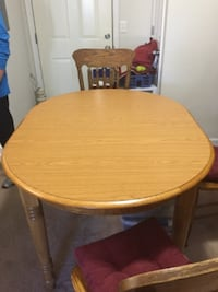 round brown wooden table with four chairs dining set RICHMOND