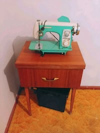 Antique sewing machine Wizard in cabinet