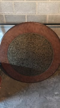 Round brown and black coffee table