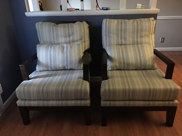 two gray striped print black wooden frame armchairs