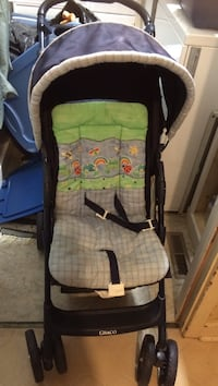 ABaby's black, green, and purple graco stroller