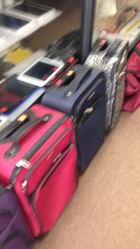 three red, blue and white-and-grey soft side luggages Columbus, 43228