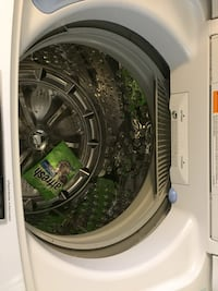 white front-load clothes washer Toronto, M3N 2B9