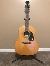 Epiphone acoustic guitar. Comes with stand and case Brighton, 48116