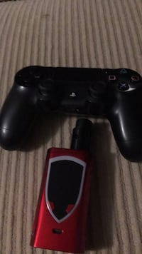 Black sony ps4 game controller SURREY