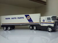 white and purple Hess truck toy