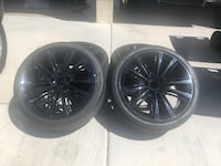 "BMW 20"" Black Factory wheels and tires"