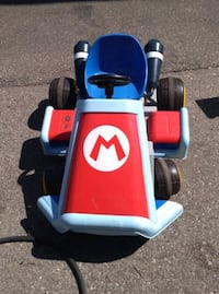 """The Motorized Ride On Mario Kart  This is the real-life Mario Kart that enables a child to live out the ultimate racing fantasy. Modeled after Mario's standard vehicle from Mario Kart, it features a dual exhaust, iconic """"M"""" on the hood, and sound effects  Toronto"""