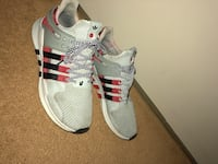Pair of white-and-red adidas running shoes Ottawa, K2L 2W2