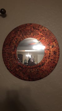 wall mirror with round brown frame
