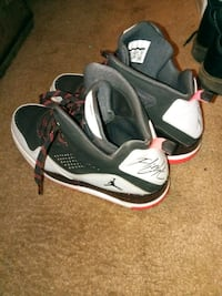 pair of gray-and-black Nike basketball shoes 691 mi