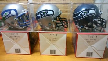 Seattle Seahawks Authentic Mini Helmets in display cases