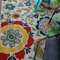 4 9x7  rugs. Very bright flowers on white