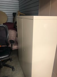 This is a two door heavy duty metal storage with 2 shelves inside no key 36x18x48  Raleigh, 27604