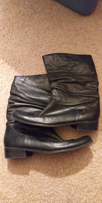 pair of black leather boots Jacksonville, 32244