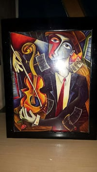 black wooden framed painting of a man playing viol Las Vegas, 89103