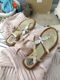 pair of brown leather sandals Surrey, V3Z 0M4