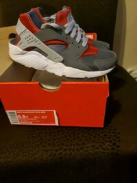 pair of gray-and-red Nike Huarache Eastpointe, 48021