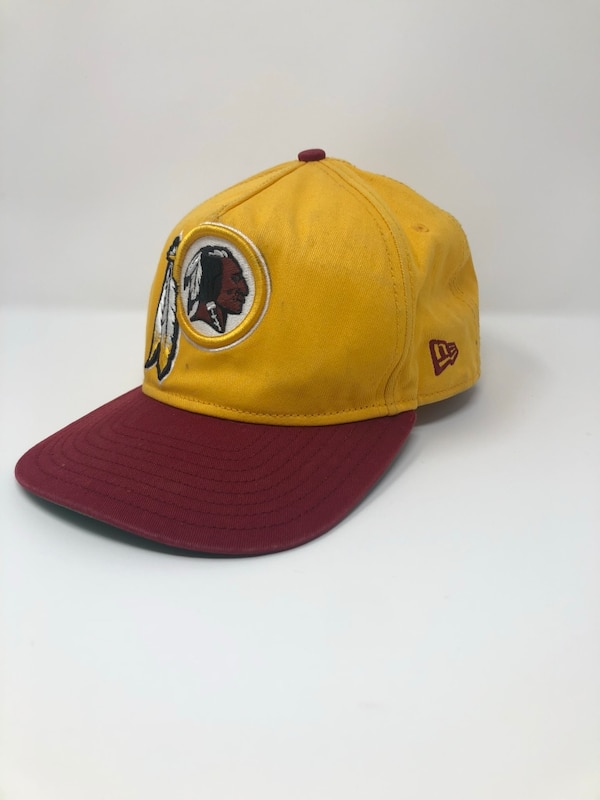 brown and black fitted cap