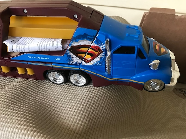 blue, yellow, and black Superman freight truck toy