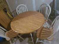 round brown wooden table with four windsor chairs Montgomery, 60538