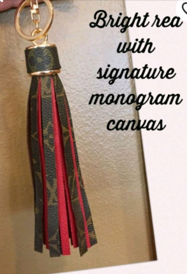 Upcycled red leather tassel bag charm. 5cfd4b16-9ef8-4a0d-9a10-83e407f9da7f