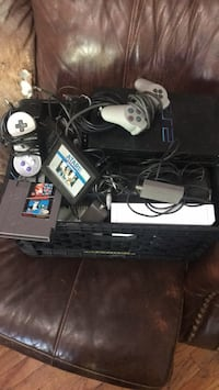 Random Vintage video game consoles and parts..