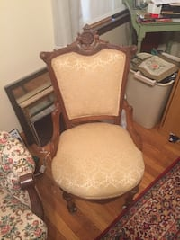 Antique brown wooden framed beige padded armchair ANNAPOLIS