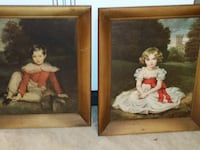 two brown wooden framed paintings of white and red puppies Fort Belvoir