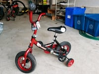 toddler's red and black training bicycle Milton, L9T 8B5