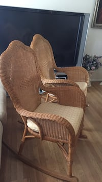 brown wicker armchair with ottoman