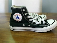 pair of black and white converse shoes
