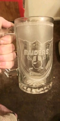 clear glass beer mug with text overlay 1658 mi