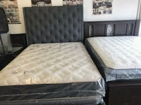 quilted white mattress and black wooden bed frame Lawndale