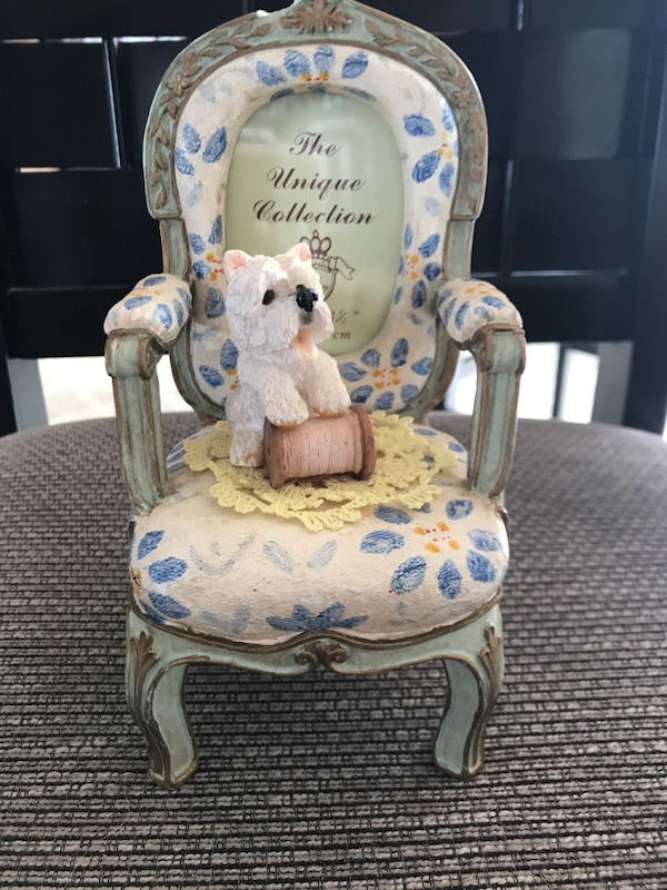 white and blue floral padded armchair