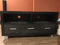 Black wooden tv stand - brand new condition. price negotiable.
