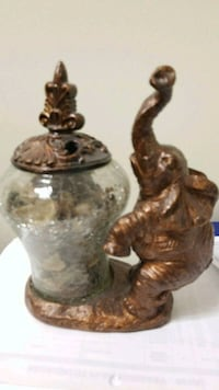 brown and black ceramic figurine elephant