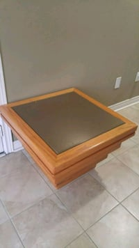 brown wooden framed glass top coffee table Mississauga, L5M 0M1