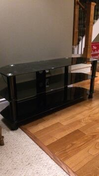 black metal base glass-top TV stand