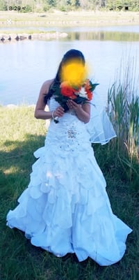 Wedding gown size small with veil and crown included