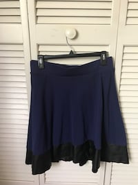 Navy knee length skirt with black pleather trim.   Winter Haven, 33884