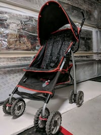 baby's black and red stroller Lancaster, 93535
