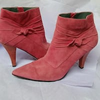 pair of pink suede heeled booties