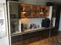 "Mirrored and glass wall unit with lighting.  113""L x 81""H x 18""D. Must be moved by buyer.   $100 or best offer Baltimore, 21215"