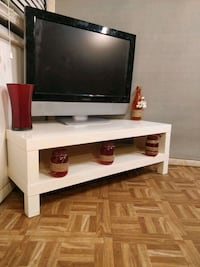 White TV stand with shelf in great condition, pet free smoke free. L39 Annandale, 22003