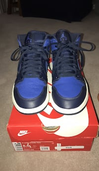 Pair of blue-and-black nike basketball shoes Toronto, M8W 4C8