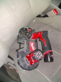 red and black cordless power drill 1461 mi